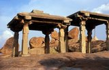 Hampi is a village in northern Karnataka state. It is located within the ruins of Vijayanagara, the former capital of the Vijayanagara Empire. Predating the city of Vijayanagara, it continues to be an important religious centre, housing the Virupaksha Temple, as well as several other monuments belonging to the old city.<br/><br/>  Jainism is an Indian religion that prescribes pacifism and a path of non-violence towards all living beings. Its philosophy and practice emphasize the necessity of self-effort to move the soul towards divine consciousness and liberation. Any soul that has conquered its own inner enemies and achieved the state of supreme being is called Jina (Conqueror or Victor).<br/><br/>  Jainism is also referred to as Shraman (self-reliant) Dharma or the religion of Nirgantha (who does not have attachments and aversions) by ancient texts. Jainism is commonly referred to as Jain Dharma in Hindi and Samanam in Tamil. Jain doctrine teaches that Jainism has always existed and will always exist, although historians date the foundation of organized or the present form of Jainism to sometime between the 9th and the 6th centuries BC.<br/><br/>  It has been hypothesized that like several traditions in Hinduism, proto-Jainism may have had its roots in the Indus valley civilization, reflecting native spirituality prior to the Indo-Aryan migration into India. In the modern world, it is a small but influential religious minority with as many as 4.2 million followers in India,and successful growing immigrant communities in North America, Western Europe, the Far East, Australia and elsewhere.